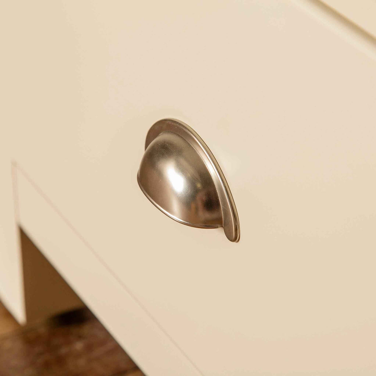 Close up of drawer metal handle on the Padstow Cream Wooden 2 Double Wardrobe