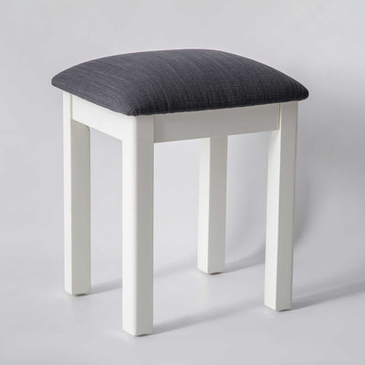 side view of the The Padstow White Wooden Dressing Stool with Padded Seat