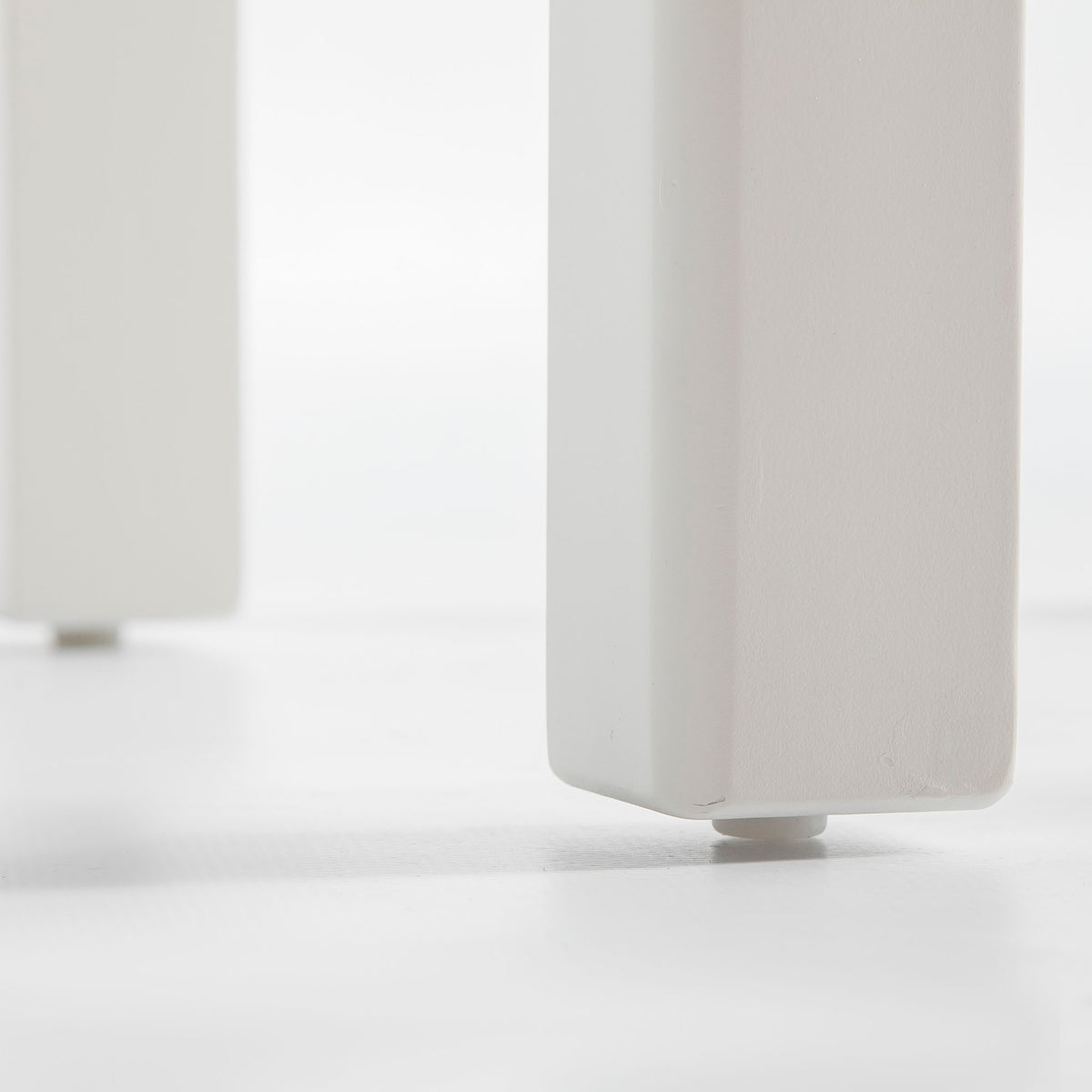close up of white painted wooden legs on The Padstow White Wooden Dressing Stool with Padded Seat