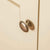 Close up of metal door knob on The Padstow Cream Large 3 Door Wardrobe