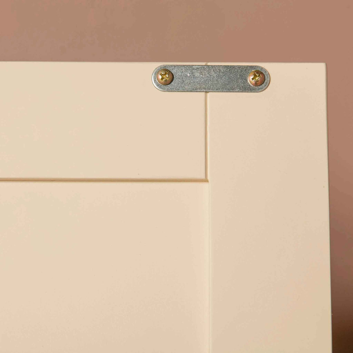 Close up of metal section for magnetic door catch on The Padstow Cream Large 3 Door Wardrobe