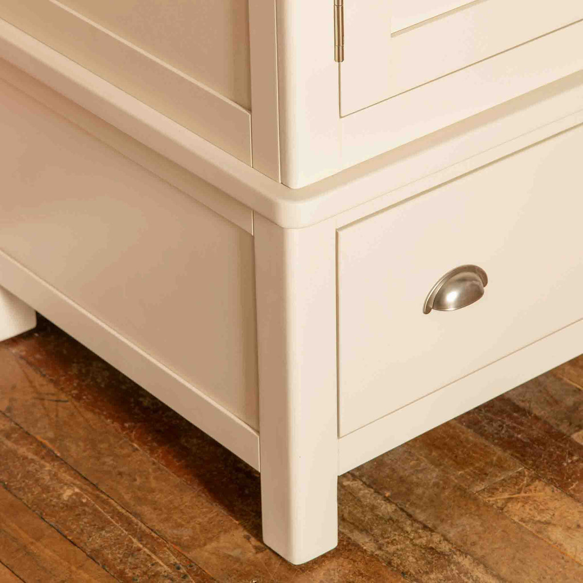 Close up of leg on The Padstow Cream Large 3 Door Wardrobe