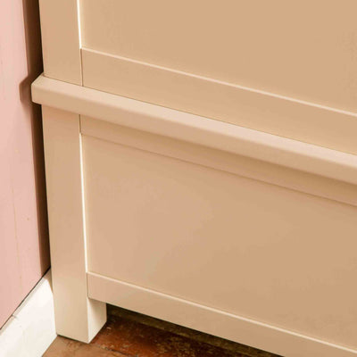 Close up of rear leg on The Padstow Cream Large 3 Door Wardrobe