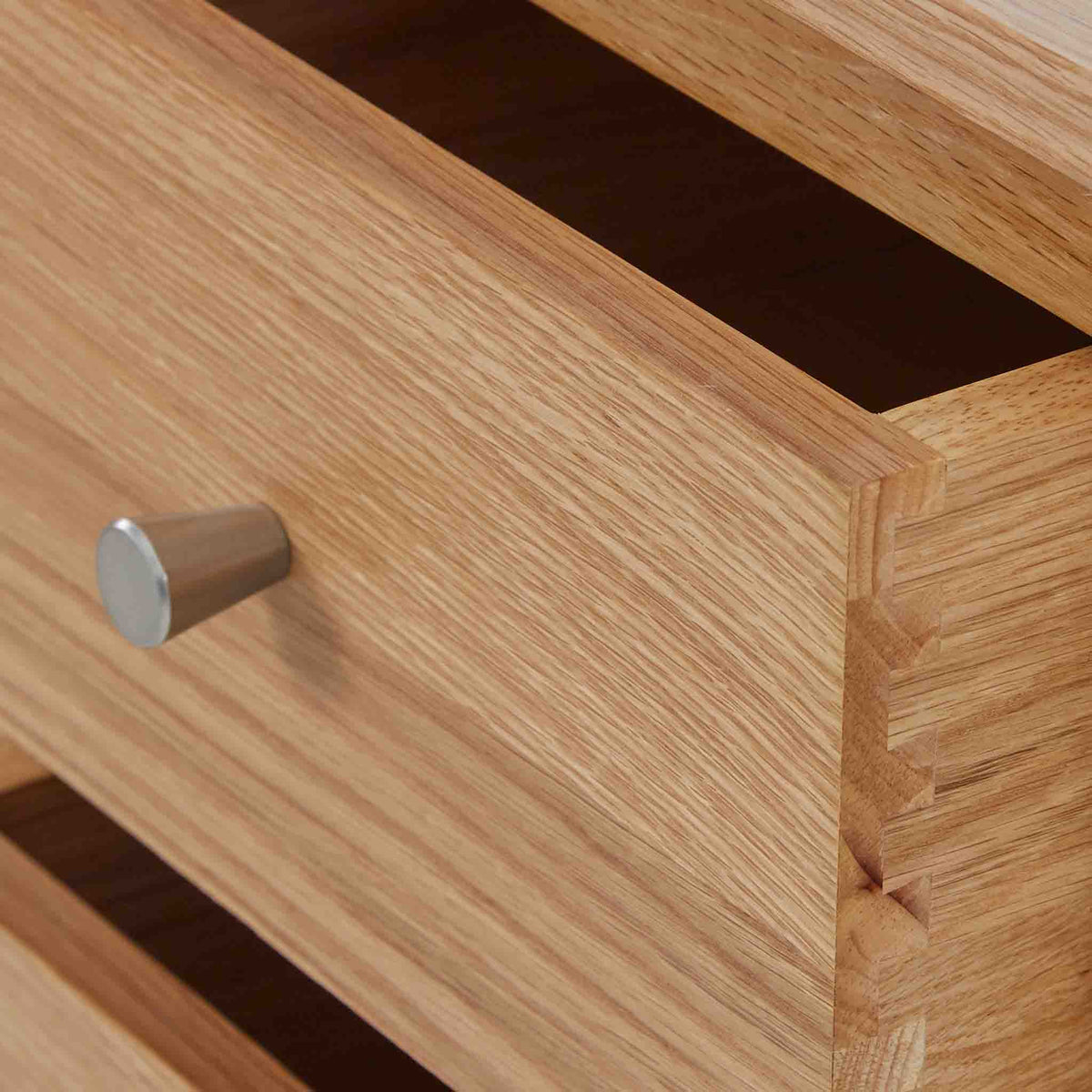close up of the dovetail drawer on the Side view of the Falmouth Oak Large TV Unit with 4 Drawers