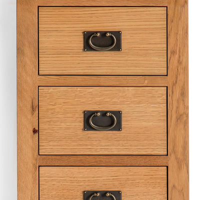 Surrey Oak 5 drawer tallboy chest of 5 drawers - Close up of drawer fronts
