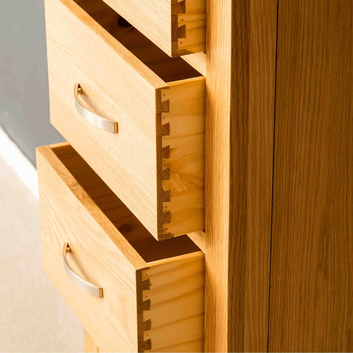 Dovetail joints on a London Oak Tallboy Chest.