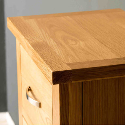 Close up of the top surface of a London Oak Tallboy Chest.