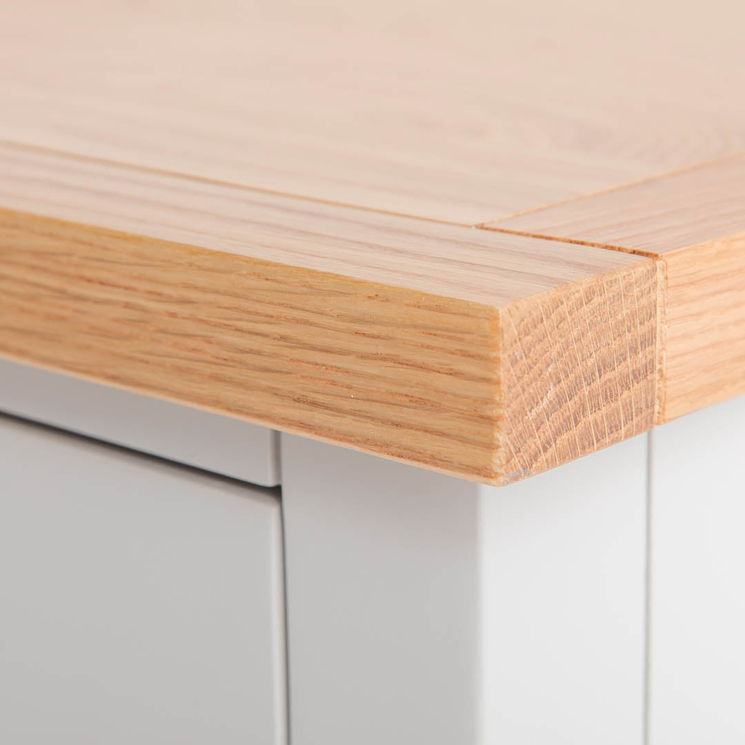 Close up of the corner oak top on the Farrow Grey Bedside Cabinet