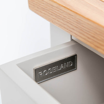 Close up of opened drawer with Roseland metal label
