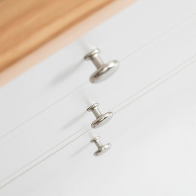 Close up of the drawers handles on the Farrow Grey 3 over 3 Chest of Drawers