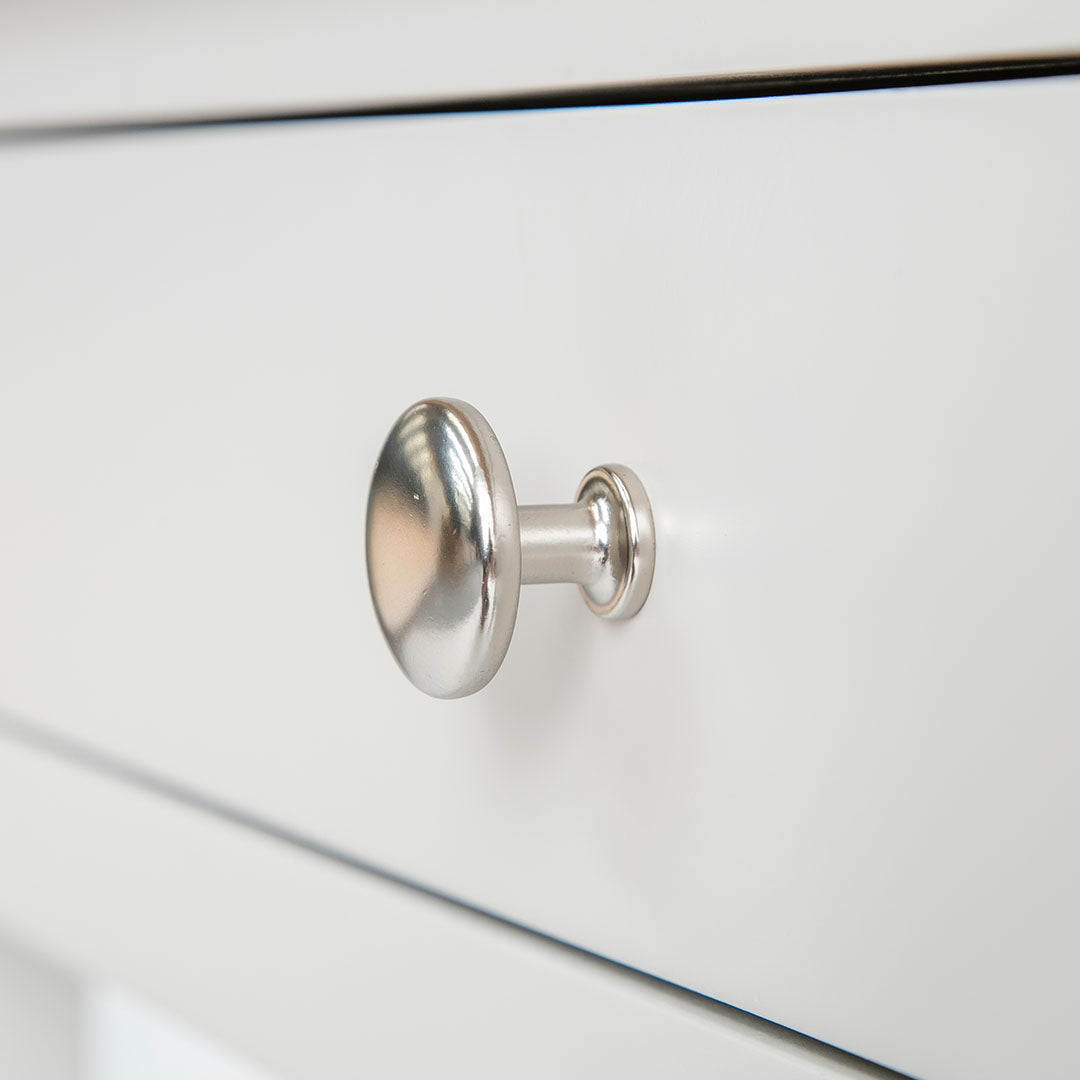Close up of the round metal handle on the Farrow Grey Dressing Table Set