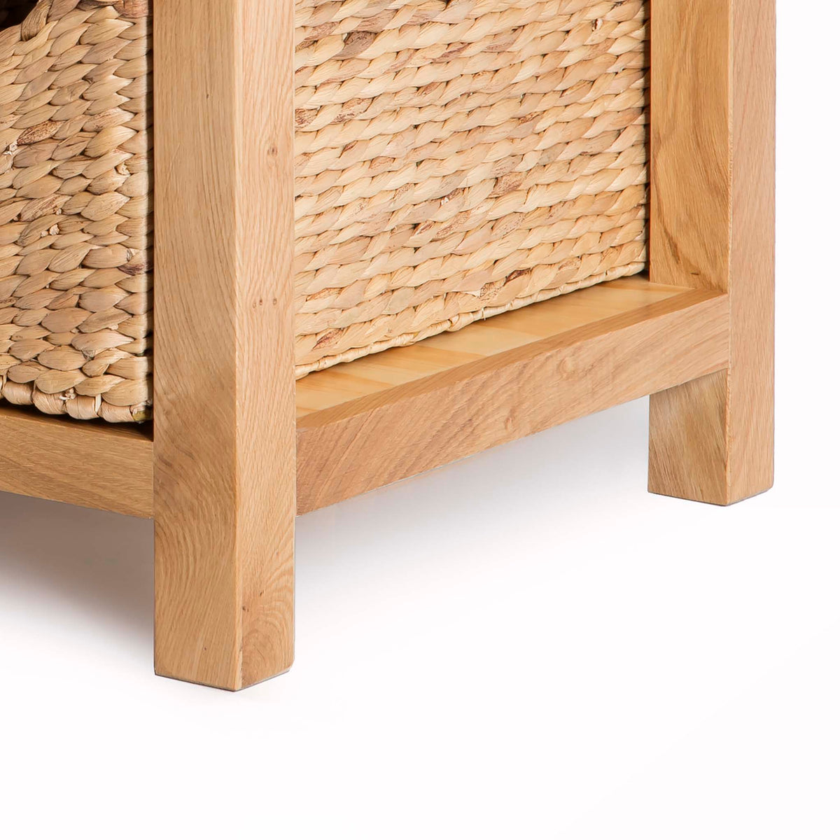 London Oak Coffee Table with Baskets by Roseland Furniture - Close up of feet on table