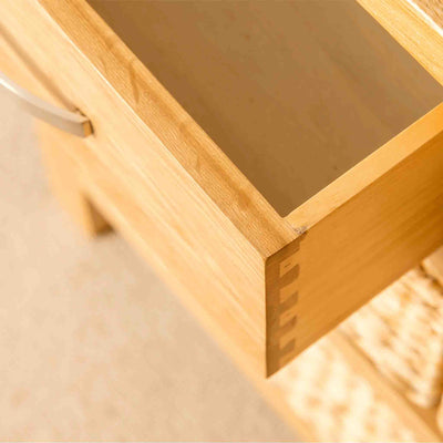 Open drawer on a London Oak Console Table with baskets.