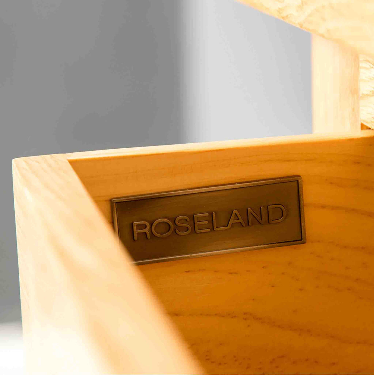 Roseland Furniture badge on a London Oak Hall Table with Baskets.