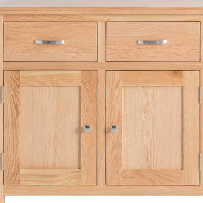 London Oak Mini Sideboard - Close up of front of cupboard, showing cupboard doors and drawers