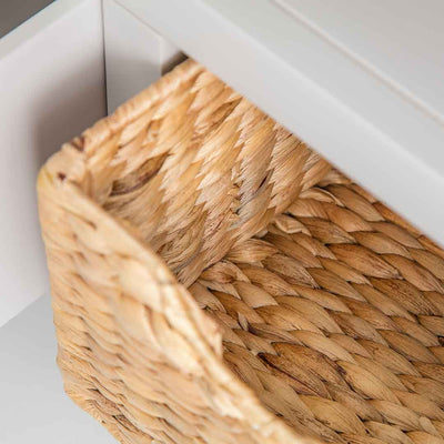 Close up of the woven baskets on the Farrow Grey Corner TV Unit with Baskets