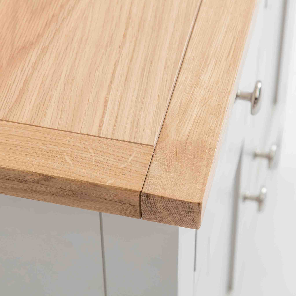 Close up of the oak top corner on the Farrow Grey Mini Sideboard