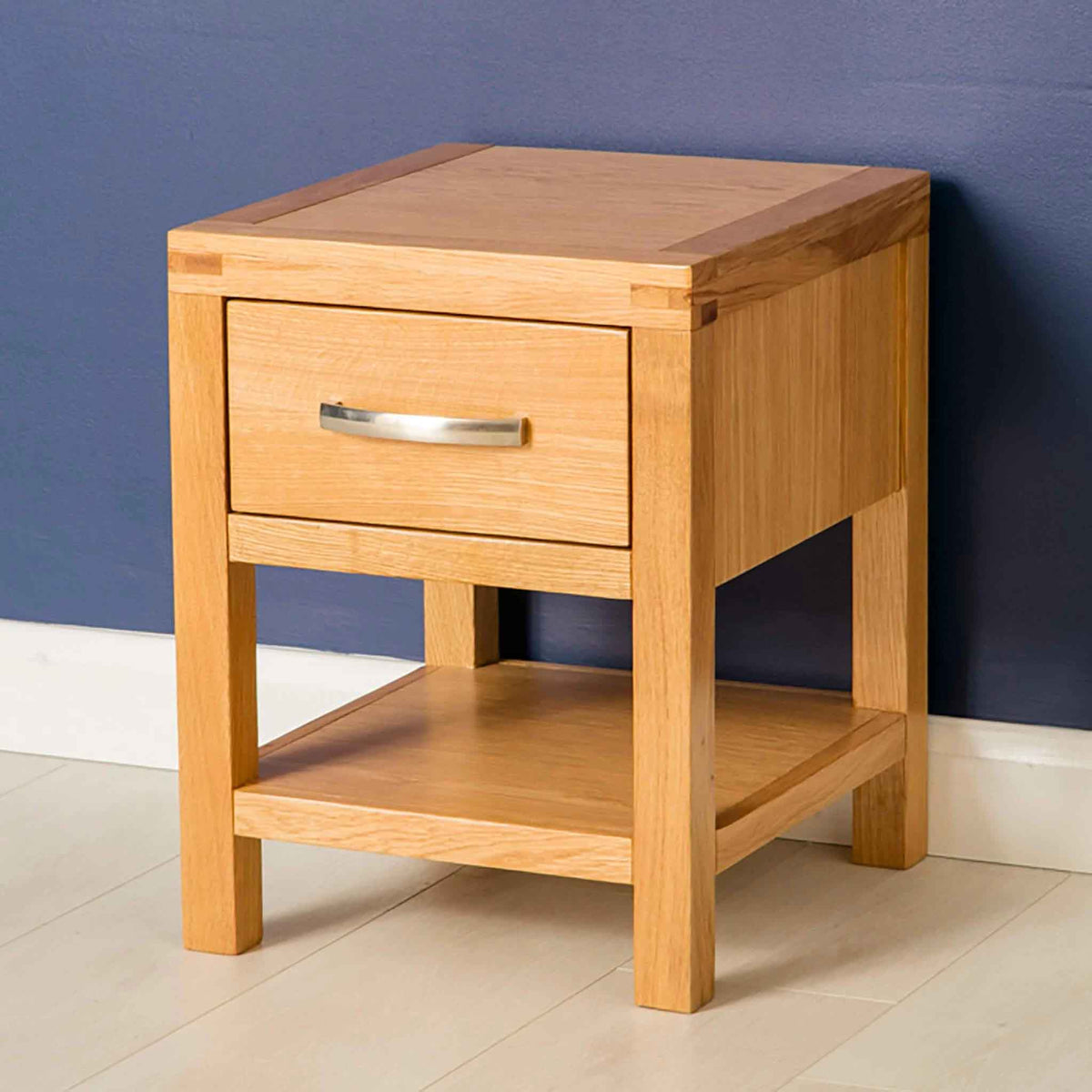 Side view of the Abbey Light Oak Wooden Lamp Table by Roseland Furniture