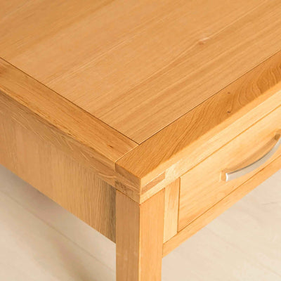 Topside corner view of the Abbey Light Oak Coffee Table with drawer from Roseland Furniture