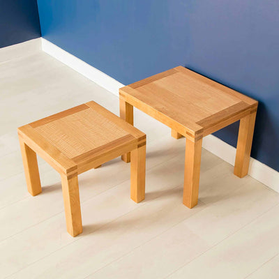 View of both Abbey Light Oak Nesting Tables by Roseland Furniture