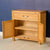 Abbey Light Oak Mini Sideboard Cupboard - Lifestyle side view with cupboard doors open