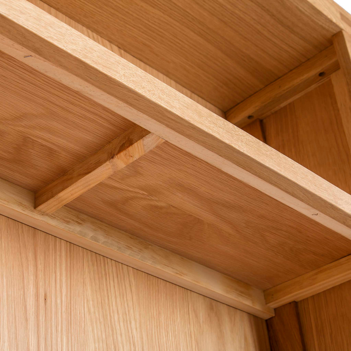 Abbey Light Oak Large Bookcase - Close up of underside of shelves