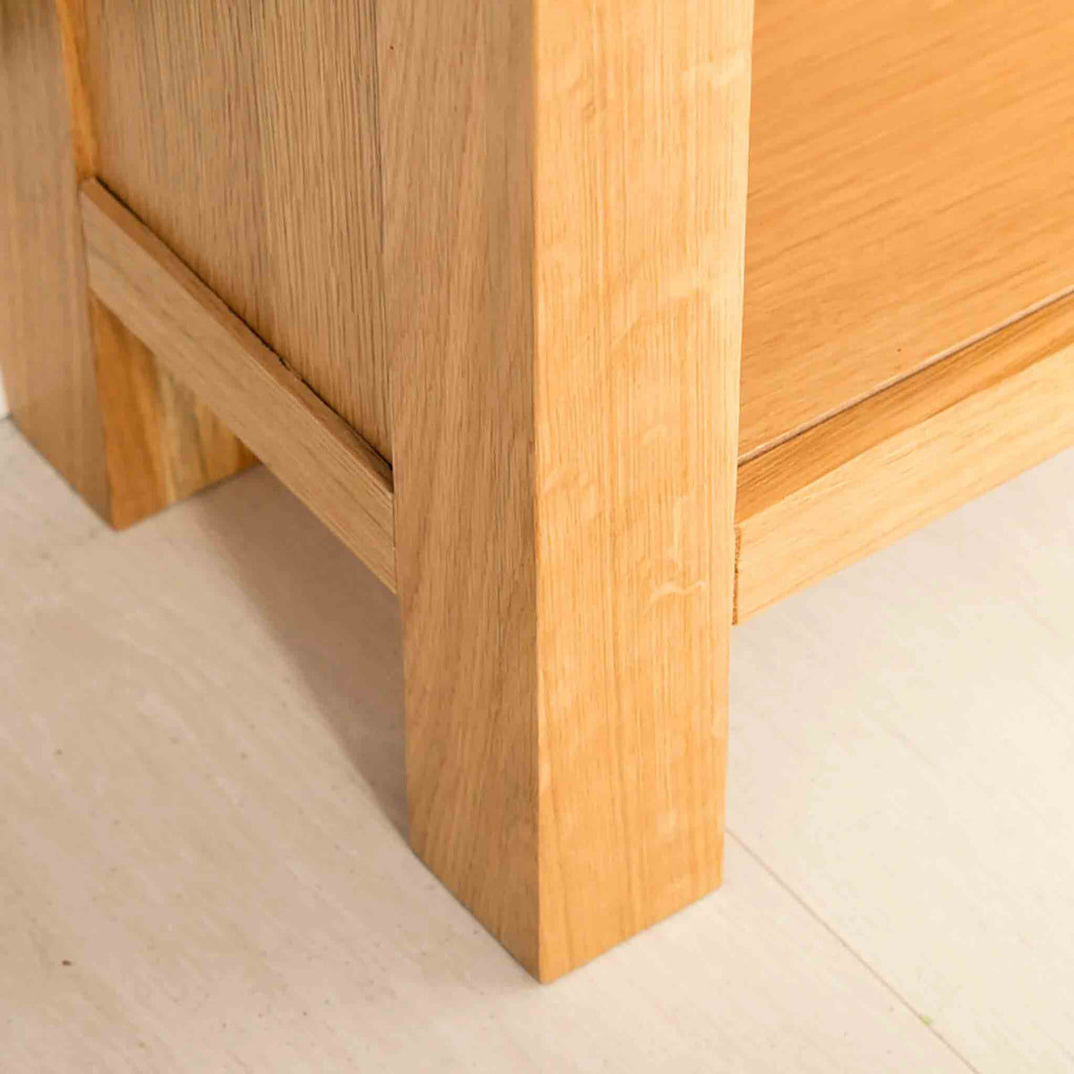 Leg view of the Abbey Light Oak Small Bookcase by Roseland Furniture
