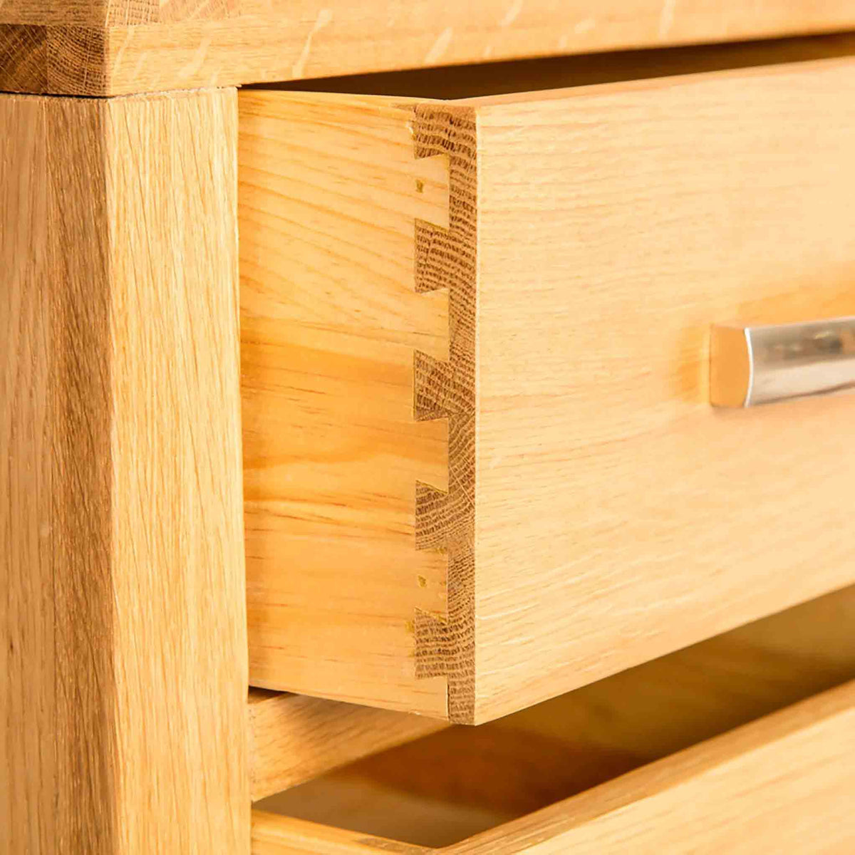 Drawer joint of the Abbey Light Oak Wooden Bedside Table by Roseland Furniture