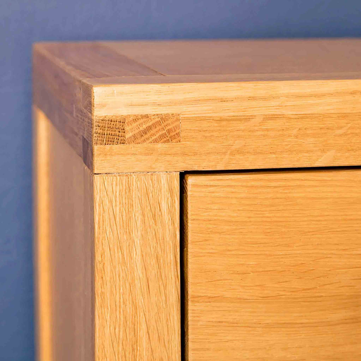 Corner view of the Abbey Light Oak Solid Wood Bedside Table by Roseland Furniture