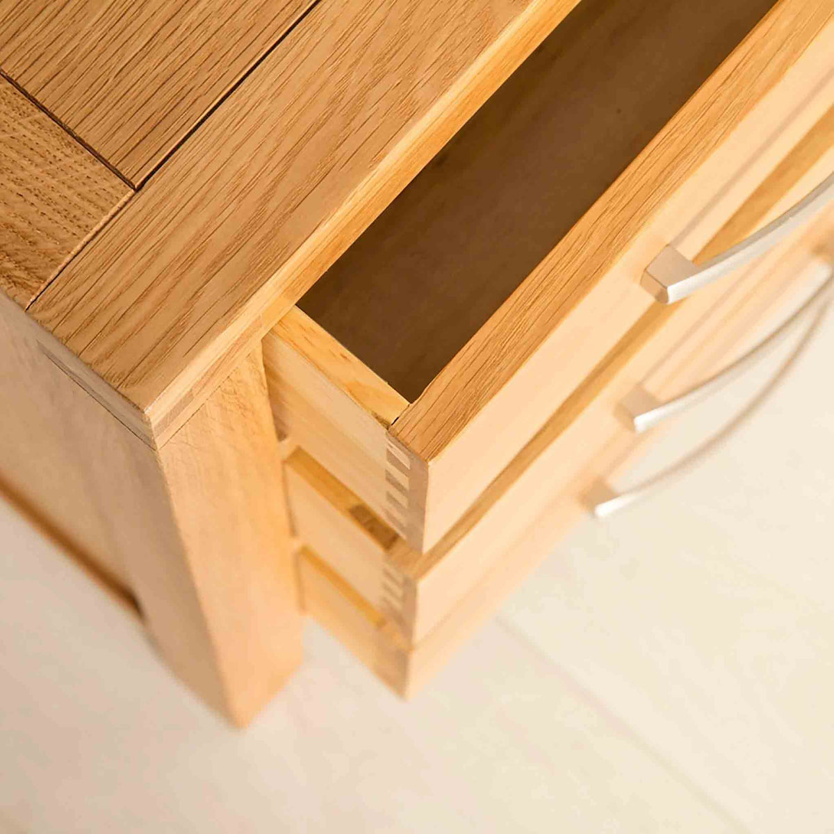 Storage Drawers view of the Abbey Light Oak Bedside Cabinet by Roseland Furniture