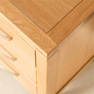 Top Corner view of the Abbey Light Oak Bedside Storage Table by Roseland Furniture