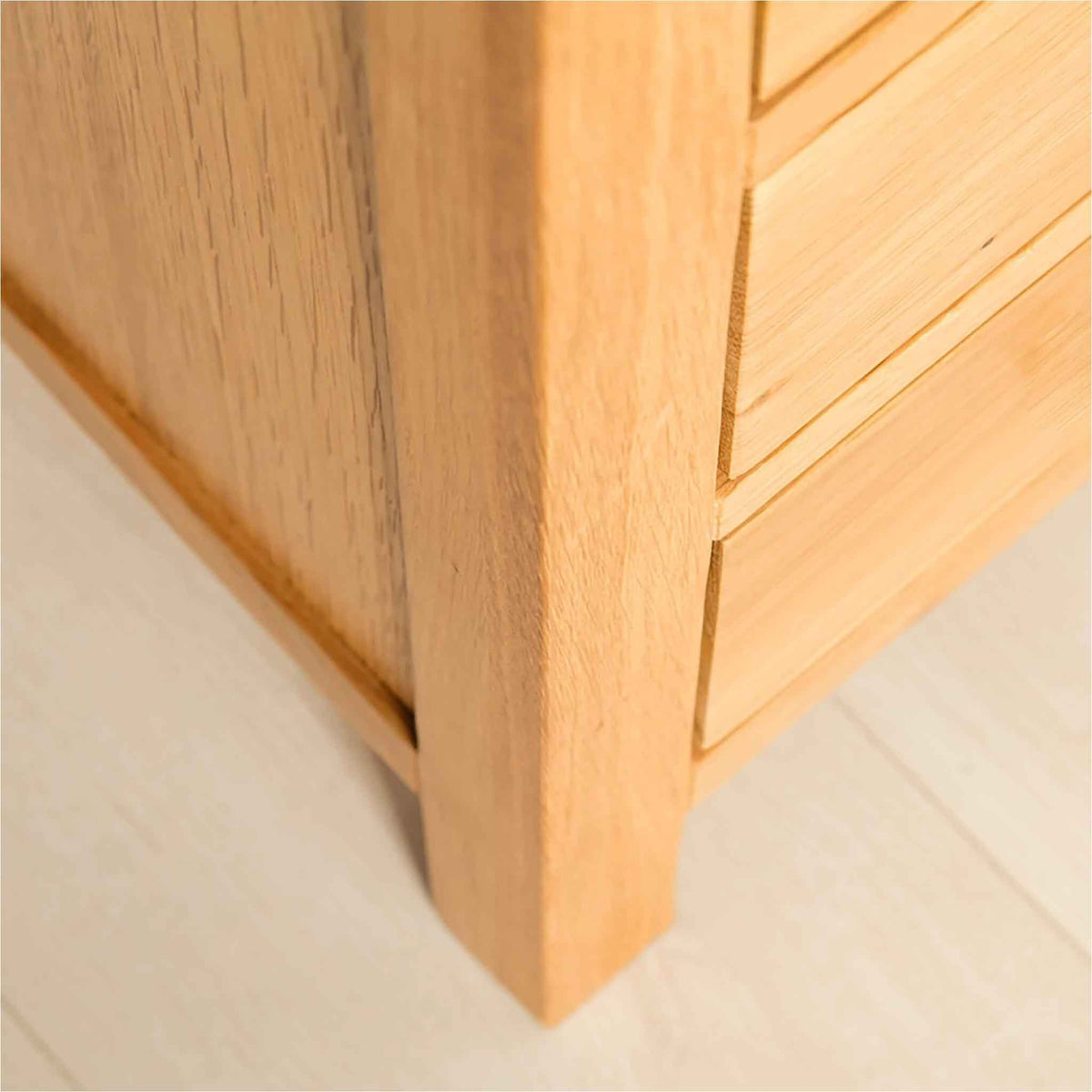 Leg view of the Abbey Light Oak Bedside Table by Roseland Furniture