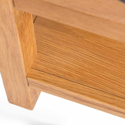 Close up of the lower wooden shelf on the Abbey Waxed Small Side Lamp Table