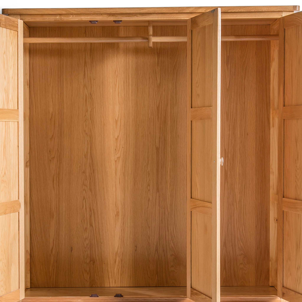 Hampshire Oak Triple Wardrobe with Drawers - Close up of inside wardrobe doors