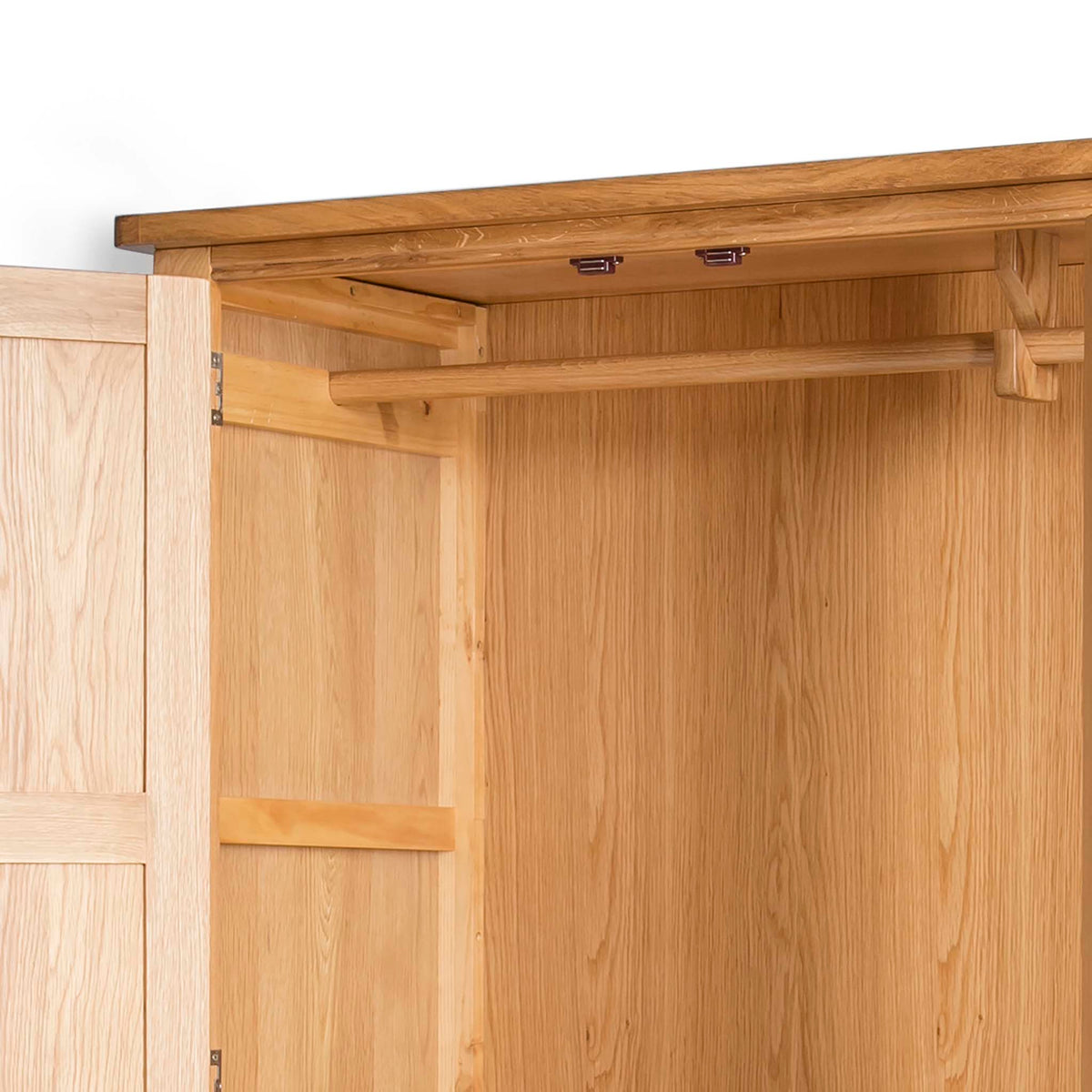 Hampshire Oak Triple Wardrobe with Drawers - Close up of hanging rail inside wardrobe