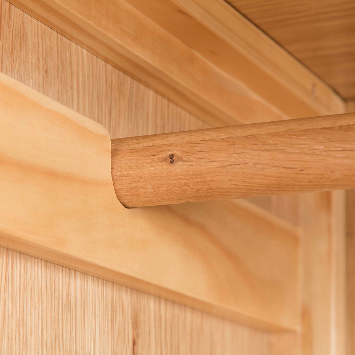 Hampshire Oak Triple Wardrobe with Drawers - Close up of end support bracket for hanging rail