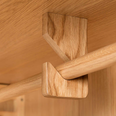 Hampshire Oak Triple Wardrobe with Drawers - Close up of mid section bracket for hanging rail