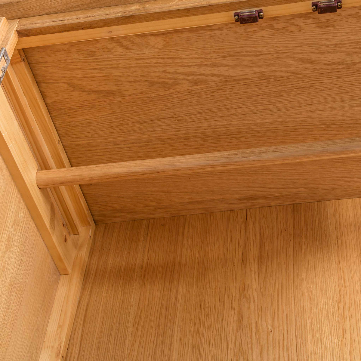 Hampshire Oak Triple Wardrobe with Drawers - Looking up at hanging rail