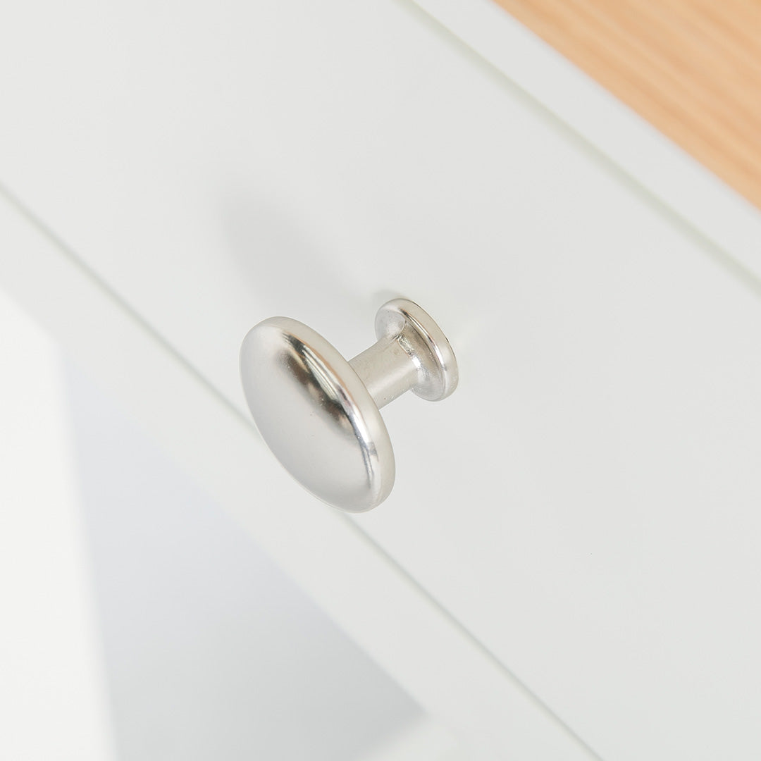 Close up of the round metal handle on the Farrow White Telephone Side Table