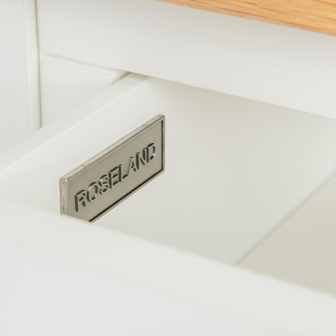 Close up of the Roseland metal label on the Farrow White Telephone Side Table