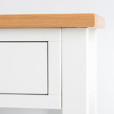 Close up of the painted solid wood frame on the Farrow White Telephone Side Table with storage drawer