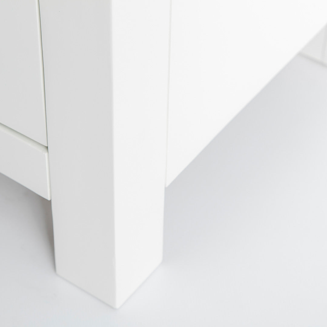 close up of the solid wood leg on the Farrow White 90cm Small TV Unit