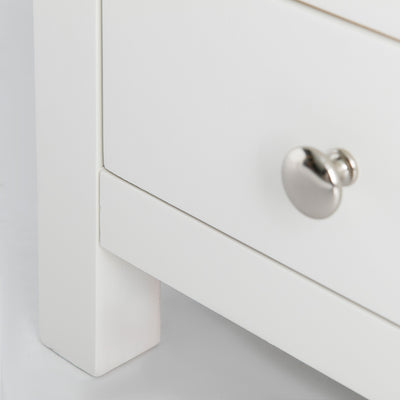close up of painted white legs on the Farrow White 3 Drawer Bedside Table