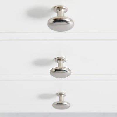 Close up of the round metal handles on the Farrow White 3 Drawer Bedside Table