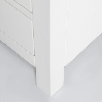 close up of the solid wood legs on the Farrow White 3 Drawer Bedside Table
