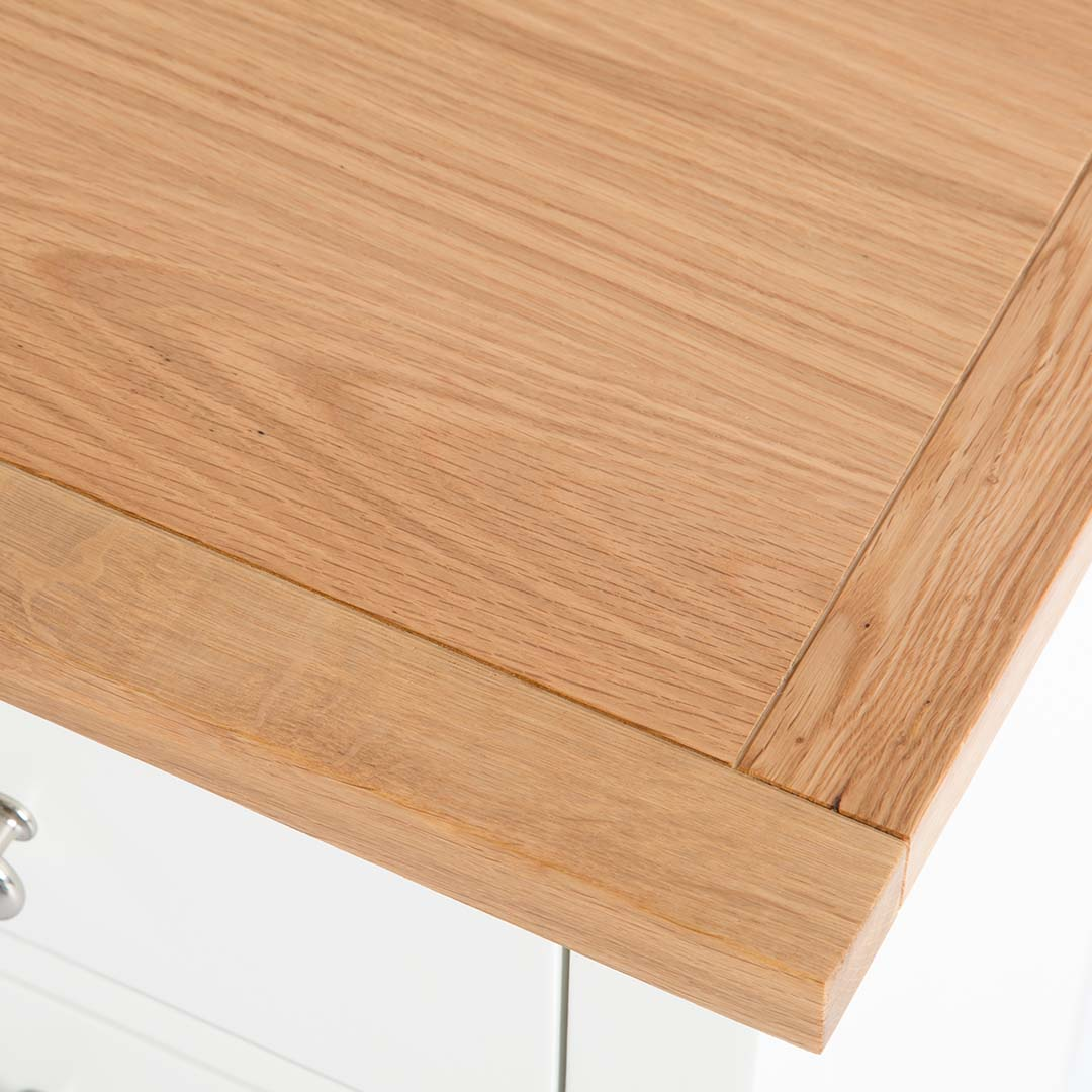 close up of oak top on the Farrow White 3 Drawer Bed Side Table