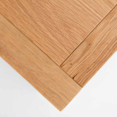 close up of oak top corner on the Farrow White 3 Drawer Bedside Table