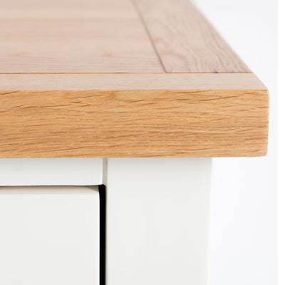Close up of oak top edge on the Farrow White 3 Drawer Bedside Cabinet
