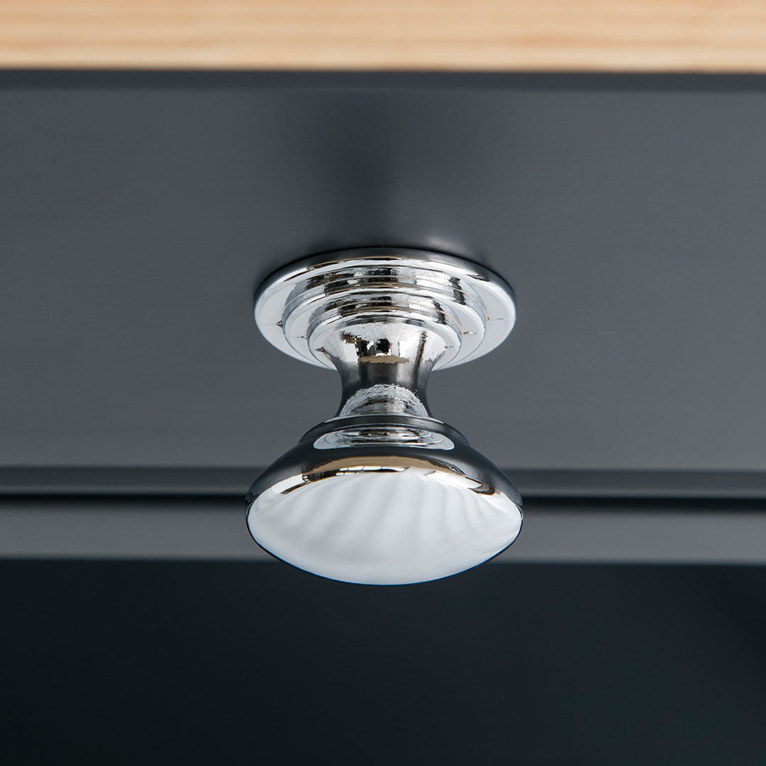 Close up of the round metal handle on the Chichester Charcoal Small Sideboard