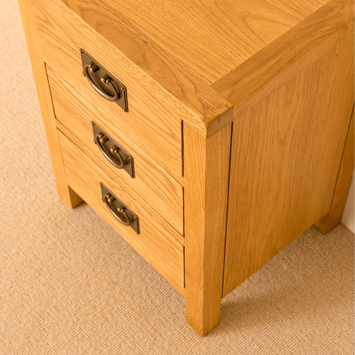 Lanner Oak Bedside Table drawers closed top view
